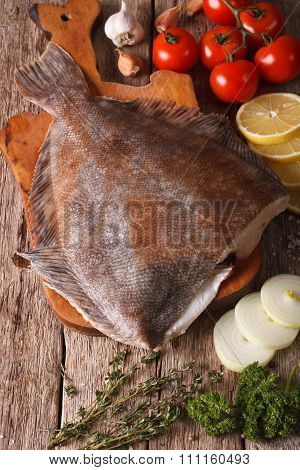 Raw Flounder With Ingredients On A Cutting Board. Vertical Top View