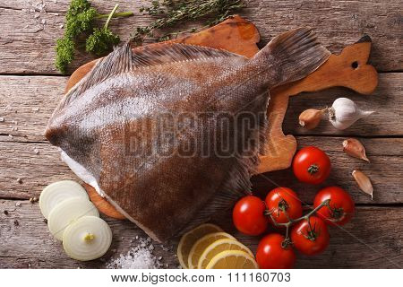 Raw Flounder With Ingredients On A Table Closeup. Horizontal Top View