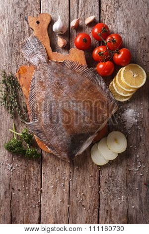 Raw Flounder With Ingredients On A Table. Vertical Top View