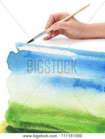 hand with paint brush and color painted background