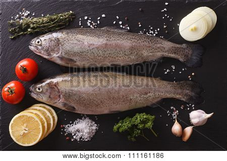 Raw Trout With Ingredients On A Slate Board Closeup. Horizontal Top View