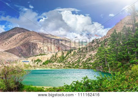 Beautiful lake in mountains against blue sky with white clouds in Annapurna area
