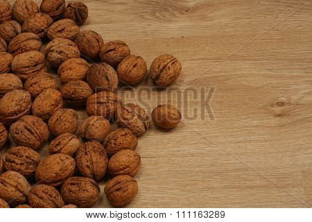 Walnuts scattered on the wooden floor