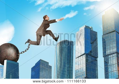 Young man in suit jumping over gap