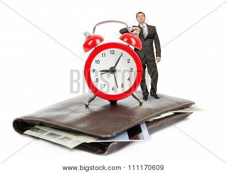Businessman standing on purse