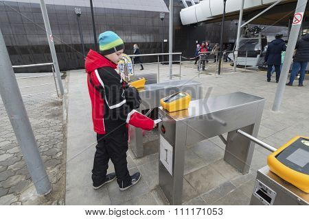 Nizhny Novgorod, RUSSIA - November 04.2015. The boy goes through the turnstile cable car. It across