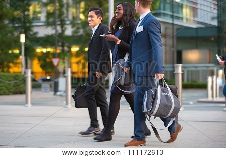 Canary Wharf business life. Business people going home after working day.