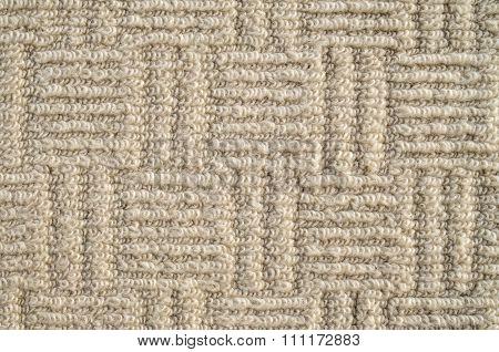 Closeup Of Beige Ornamental Carpet