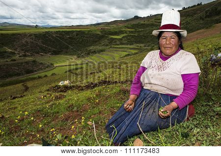 Peruvian woman the hills around the Moray Inca Terraces