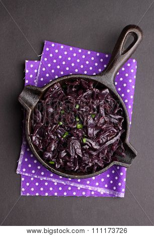 braised red cabbage in a small black pan