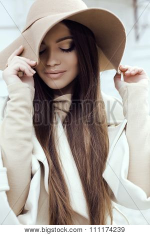Glamour Girl With Dark Straight Hair Wears Luxurious Beige Coat With Elegant Hat