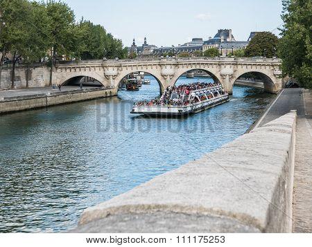 Loaded Passenger Ferry Heads Under Pont Neuf On The Seine, Paris