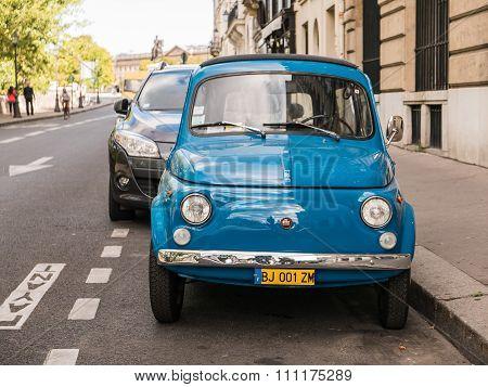 Blue Fiat Parked On A Paris Street On Ile De La Cite