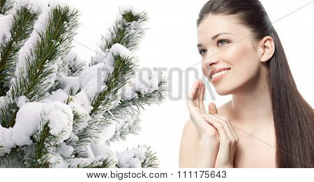 portrait of attractive  caucasian smiling woman brunette isolated on white studio shot christmas tree covered with snow