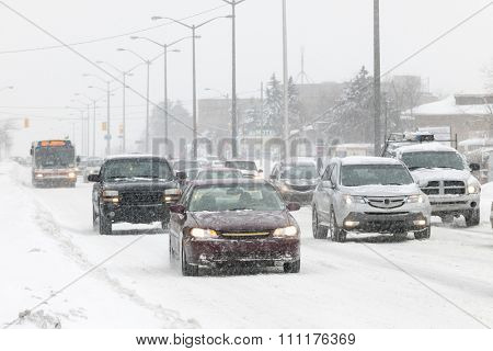 Cars driving on slippery road during heavy snowfall in Toronto