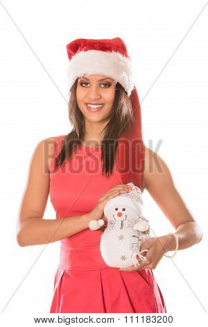 Mixed Race Woman In Santa Hat With Little Snowman.