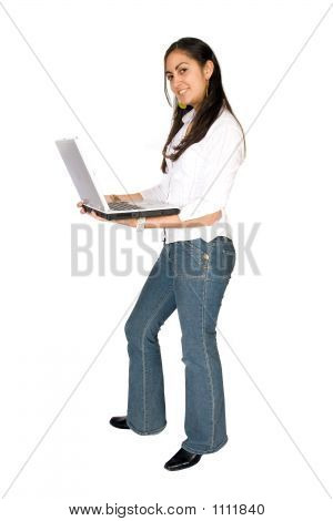 Girl Standing With A Laptop