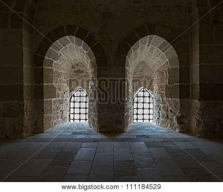 Stone Wall With Two Adjacent Back Lit Windows With Steel Grid