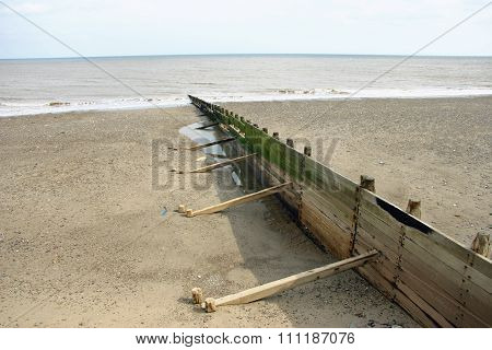Beach, breakwater and sea