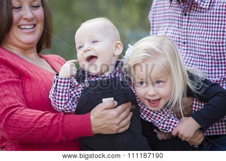 Mommy and Daddy Having Fun with Cute Baby Brother And Sister.