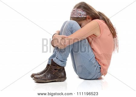 Little Girl Sitting On The Floor And Sulking, White Background