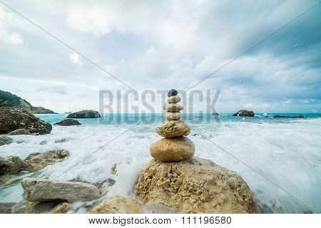 Sea dramatic landscape, harmony environment and zen stones tower silhouette.