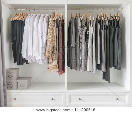White Wardrobe With Clothes Hanging