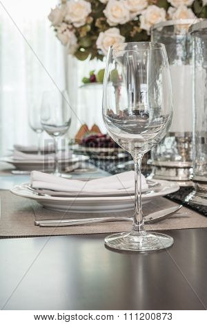 Empty Wine Glass On Wooden Dinning Table With Table Set