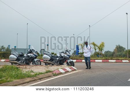 One Police Stands On The Road With Two Big Motorcycle