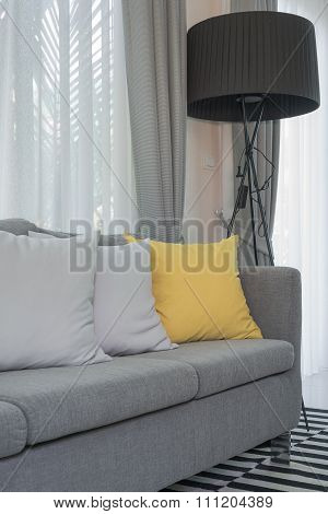 Yellow And Grey Pillows On Modern Sofa