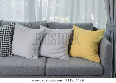 Yellow Pillow On Grey Sofa In Modern Living Room