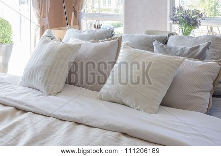 Earth Tone Color Pillows In Luxury Bedroom