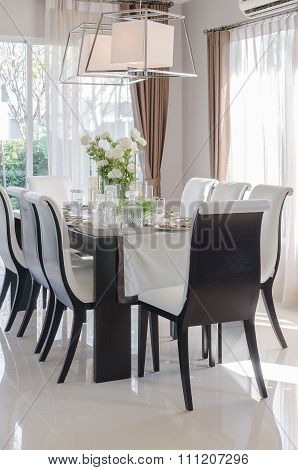 Modern Dinning Room With Black Wooden Table And Chair