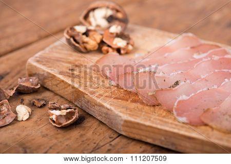 dried pork tenderloin on a rough wooden rustic table