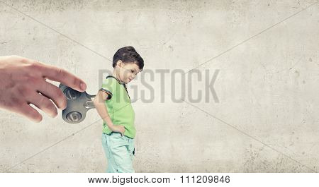Little cute active boy with key on back