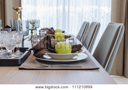 Table Set On Wooden Table In Dinning Room