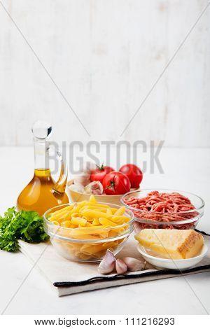 Italian food ingredients: pasta, tomatoes, minced