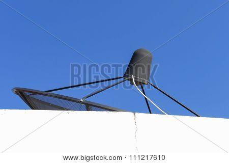 Black Satellite Dish On White Building
