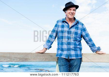 Portrait of an od man next to ocean