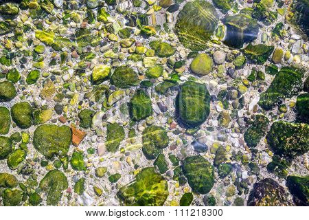 Stony Seabed Through Transparent Water