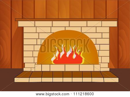 Burning fireplace at home on a wooden background