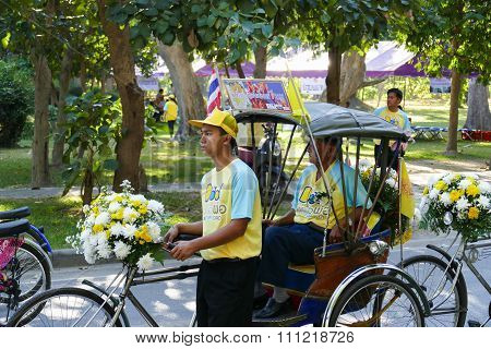 The Son Waiting To Take Their Dad On Tricycle To Ride Around Chiang Mai City In