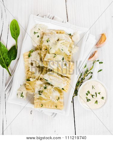 Ravioli With Spinach And Ricotta Cheese On White Plate