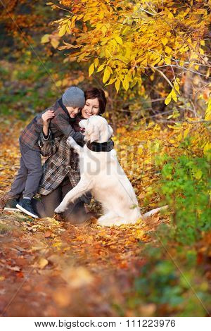 Happy mom and her son with dog