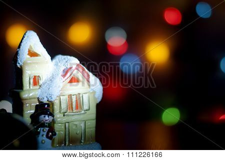 Christmas light house on a background of colorful bokeh