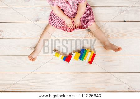 Little Girl On Wooden Floor Playing