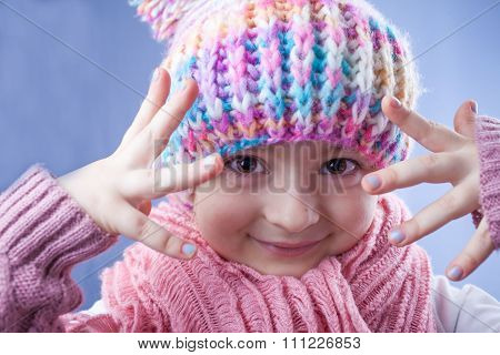 Little Girl In Knitted Hat, Scarf And Mitten