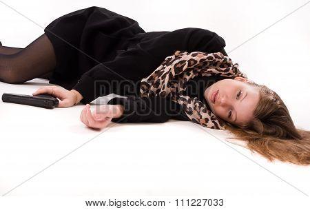 Spy Girl With Gun Lying On The Floor