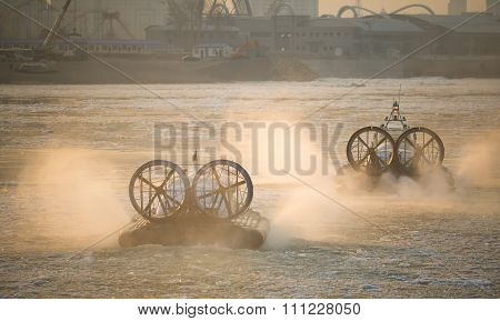 Two Russian ACV Hovercraft in Action on a Frosen River. Air Cush