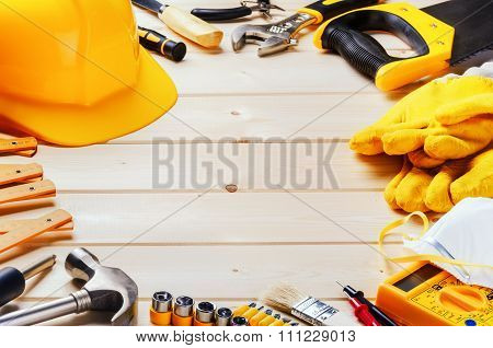 Frame With Various Tools On Wooden Background